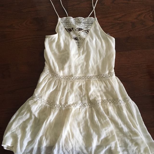 Cream dress with adjustable back and crotchet detailing