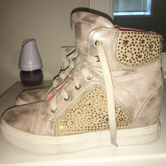 women's pair of brown wedge sneakers