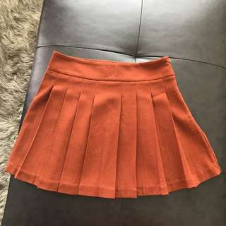Orange pleated skirt size s