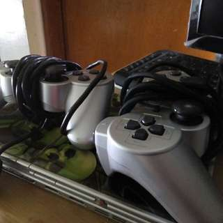 PS2 WITH CONTROLLER AND GAMES
