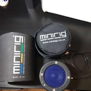 Black and blue Minirig portable speaker with case
