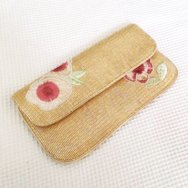 Exquisite beaded yellow and pink clutch