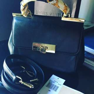 Authentic Michael Kors Marlow ( Black with gold backel ) .
