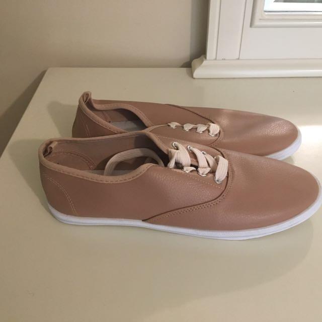 pair of brown low top sneakers