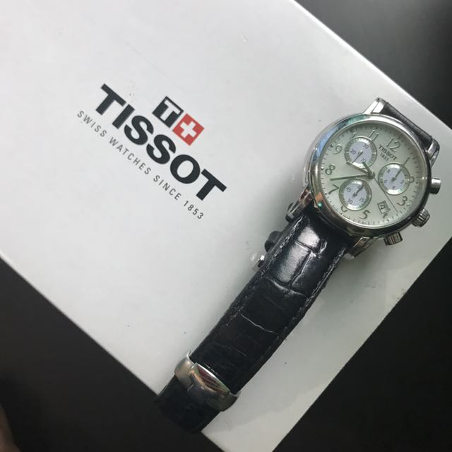 Tissot black leather watch