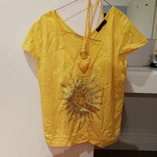 yellow shirt with sun pattern size 10