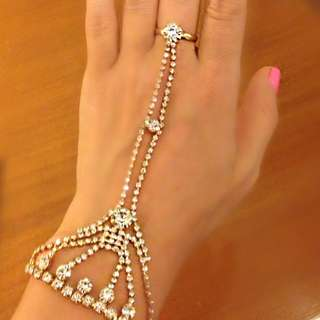 Indian jewelry (two bracelets and unworn earrings)