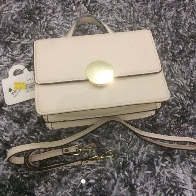 Broken white sling bag