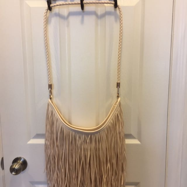 Cream coloured fringe bag