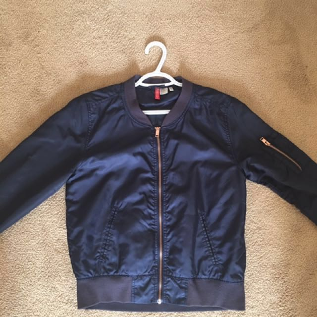 Navy bomber with rose gold zip