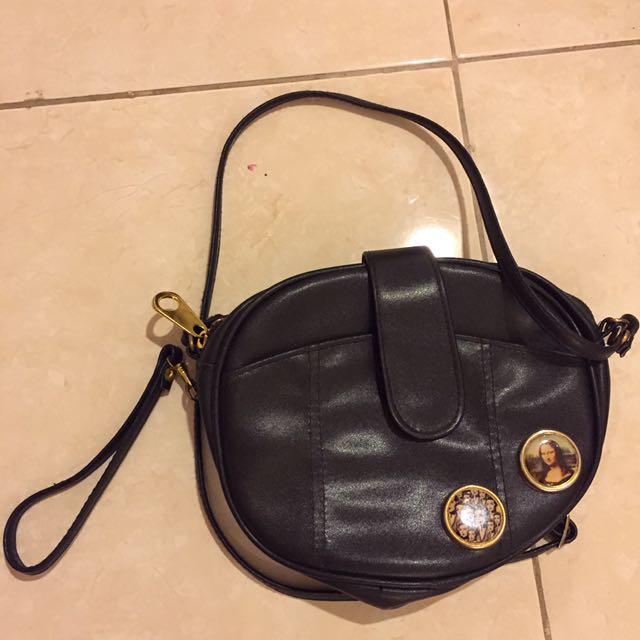 Vintage black sling bag