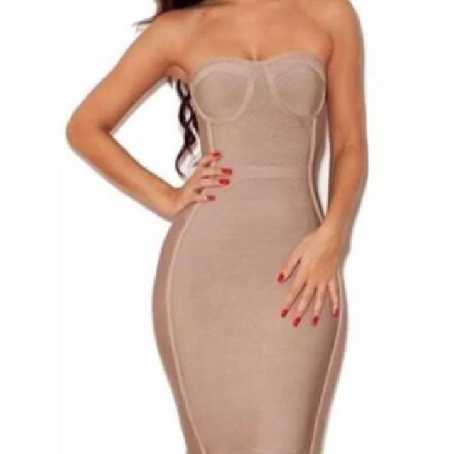 Nude bandage dress with peplum frill