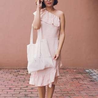 One shoulder ruffled dress in blush.