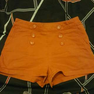 Orange High Waisted Shorts With Pocked