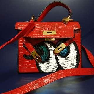 Red sling bag sequin