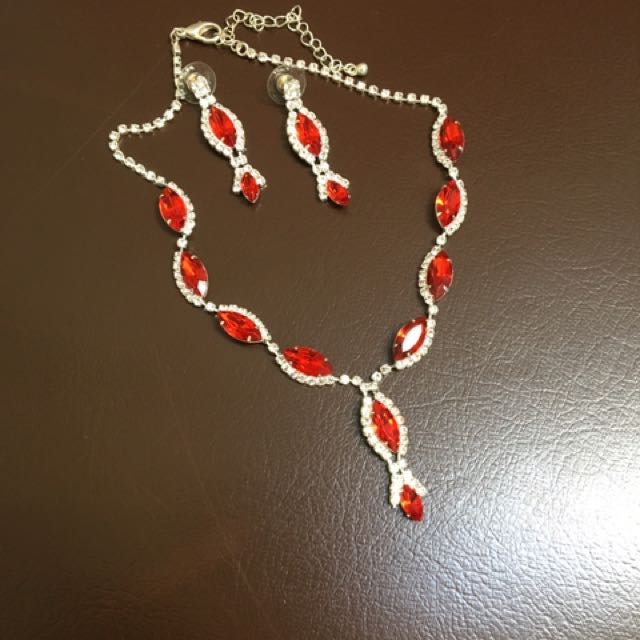 red necklace and earrings