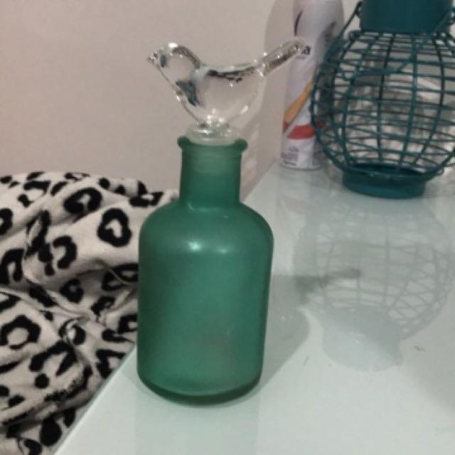 Teal glass bottle