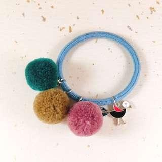Colorful pom pom hair tie