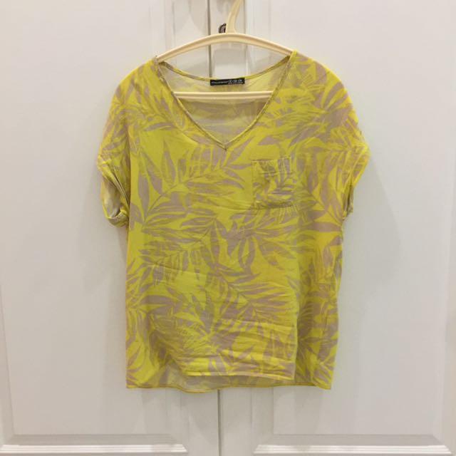 Atmosphere yellow shirt