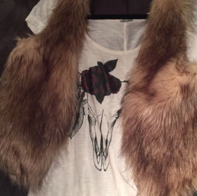 Small fur vest and small steer head shirt