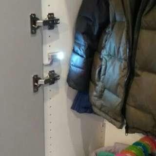 Cabinet door lighting system