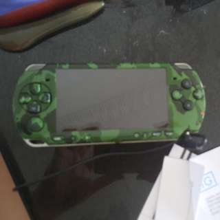 PSP includes charger+free 2 umd( Gta liberty and starwars battlefront) + memory card(with many games)