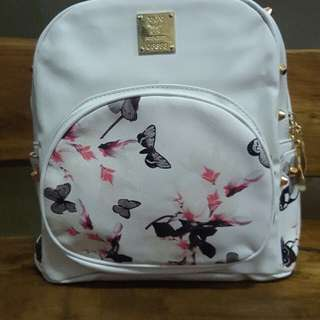 white butterfly bag