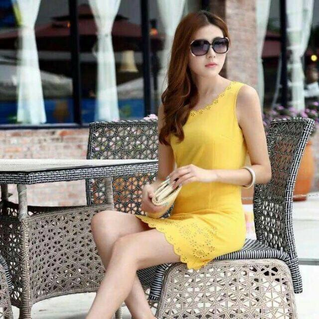 Yellow casual dress with laser cut details