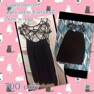 Caged sleeves mini dress, medium -semi large. New with tags. FEEL FREE TO HAGGLE!