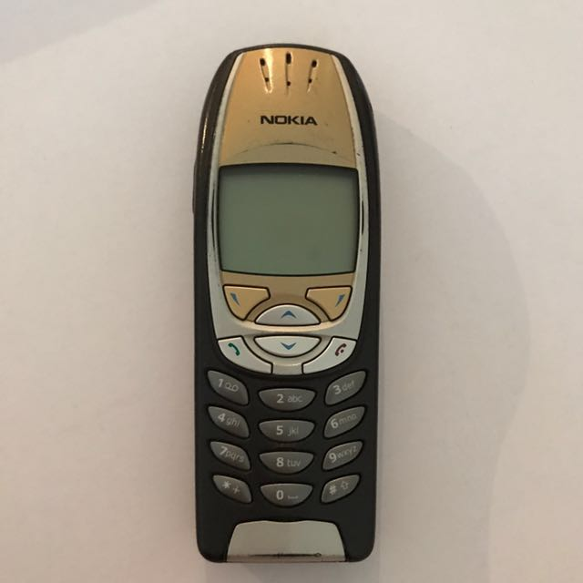 Old-school Nokia phone - gold and silver. Collector's item ...