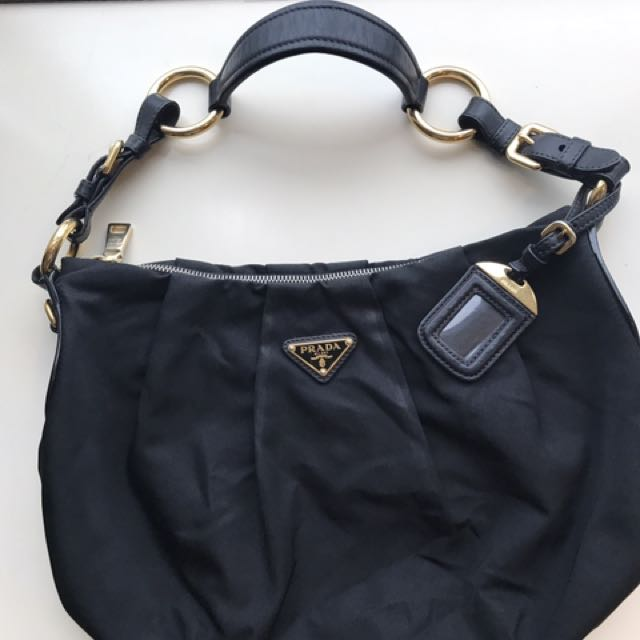 86cd0fdd061f Prada sling bag (authentic)
