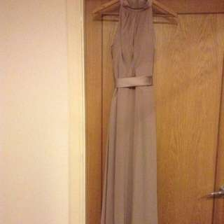 Beige floor length dress with buttons up then back