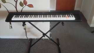 Yamaha NP30 76-Key Portable Grand Piano with pedal and stand