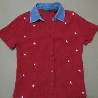 Red polo shirt with stars