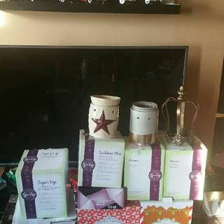 selling my scentsy lot. would like to sell it as a bundle. 2 of the warmers there are 80.00 by themselves