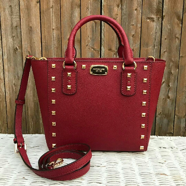 e4eca7ff8db5 Michael Kors Sandrine Stud Small Crossbody in Cherry, Luxury, Bags &  Wallets on Carousell