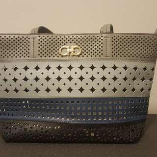 Authentic Salvatore Ferragamo Perforated Leather bag