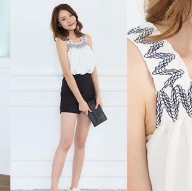 Light blue sleeveless top