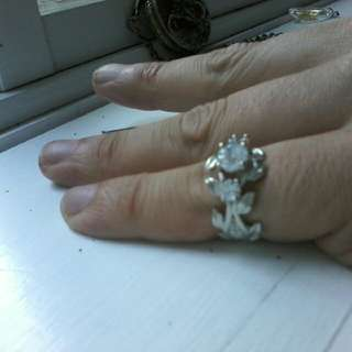 Silver ring with topaz in a floral design. Size 7