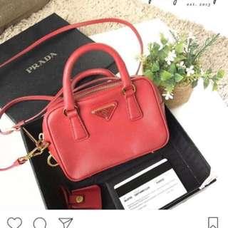 Authentic Prada saffiano lux mini sling bag