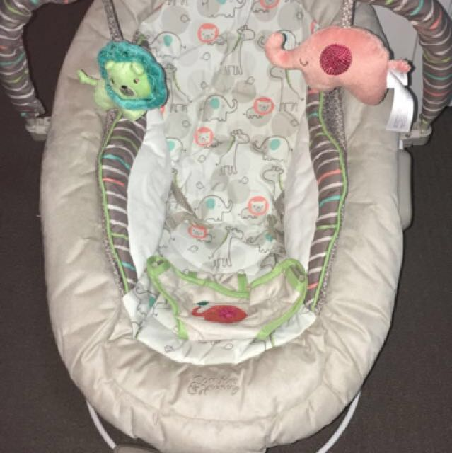 Baby cradling bouncer with vibration and music