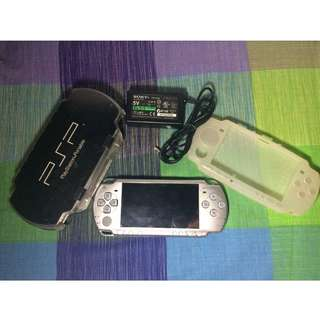 PSP 2001 Slim Complete Package with Charger. Cases and Memory Card