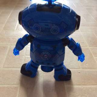 This Is One Of A Kind It's A Discotheque Dancing But The Top Of The Head Has Disco Colours It's Operates With Batteries It Swivels Around And It Does The Moon Walk