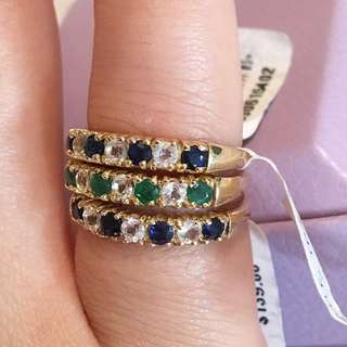 Three yellow gold birthstone rings