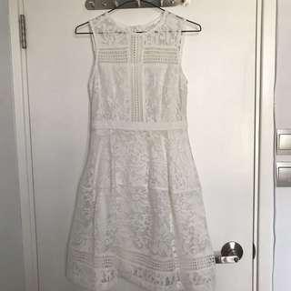 One piece white sleeveless lace dress