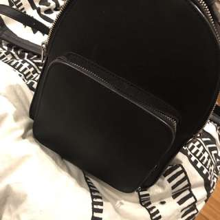 Miniature black backpack