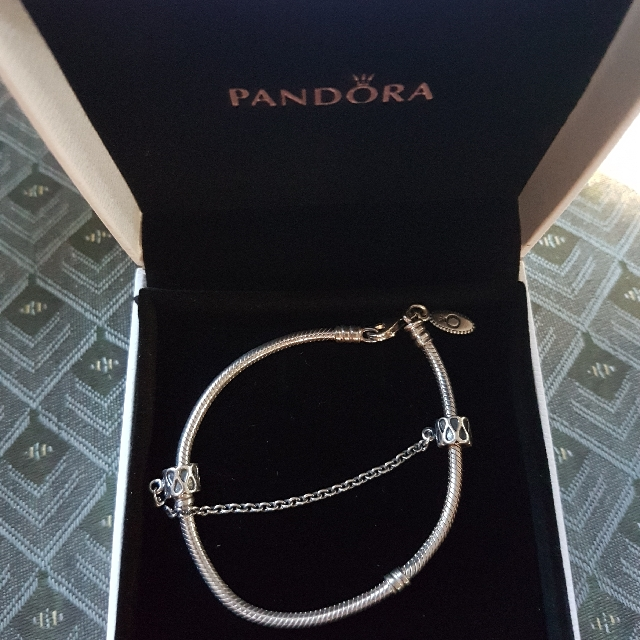 Authentic Pandora bracelet with chain stopper