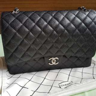 **sold***best price*Chanel classic double flap maxi in carviar