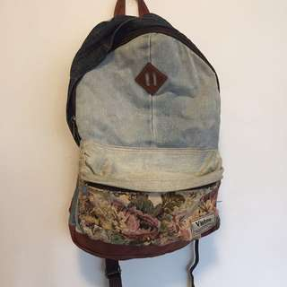 Denim, floral and leather backpack