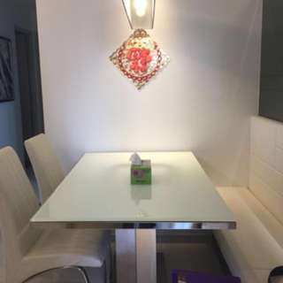 Glass white dining tables and 4 chairs
